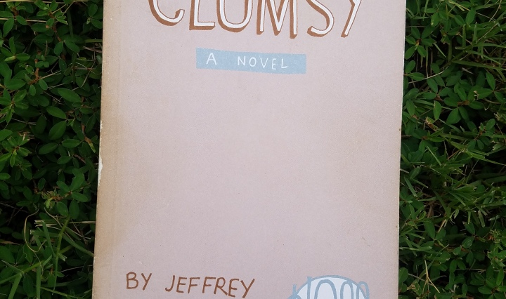 Book Cover, Graphic novel by Jeffrey Brown, book in grass